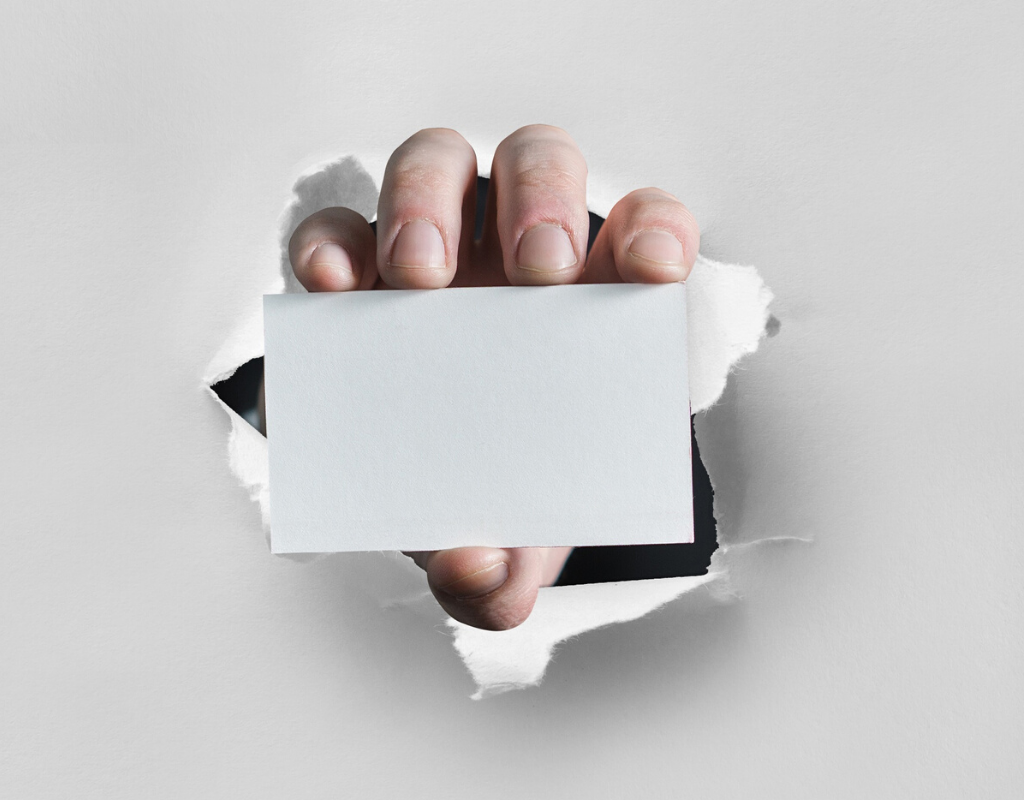 A man holding a blank white card