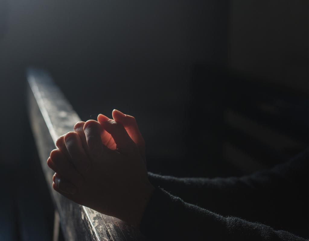 Person praying in church