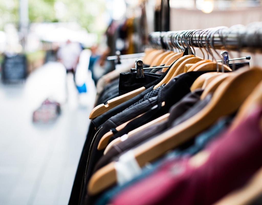 Clothes in hanger rack in open market